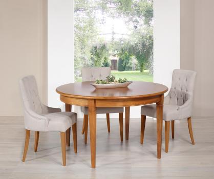 Table ronde Célia réalisée en merisier de style Directoire Diamètre 130 - 1 allonge incorporée rangée sous le plateau SEULEMENT 1 dans une finition merisier blond